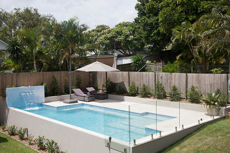 pool renovation with lounge chairs and waterfall grange