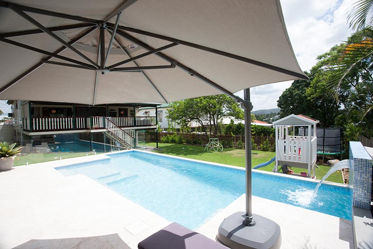 new pool with umbrella shade and cubby house grange