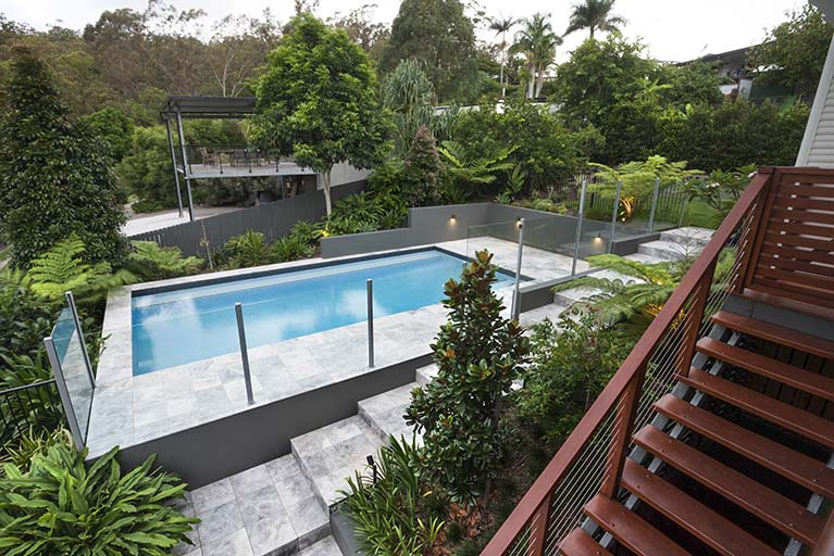 stairs of house overlooking pool renovation moorooka