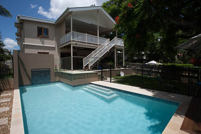 queenslander with balcony overlooking pool holland park