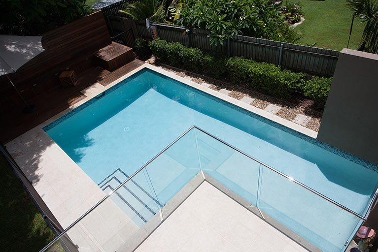 new pool with modern glass fence holland park