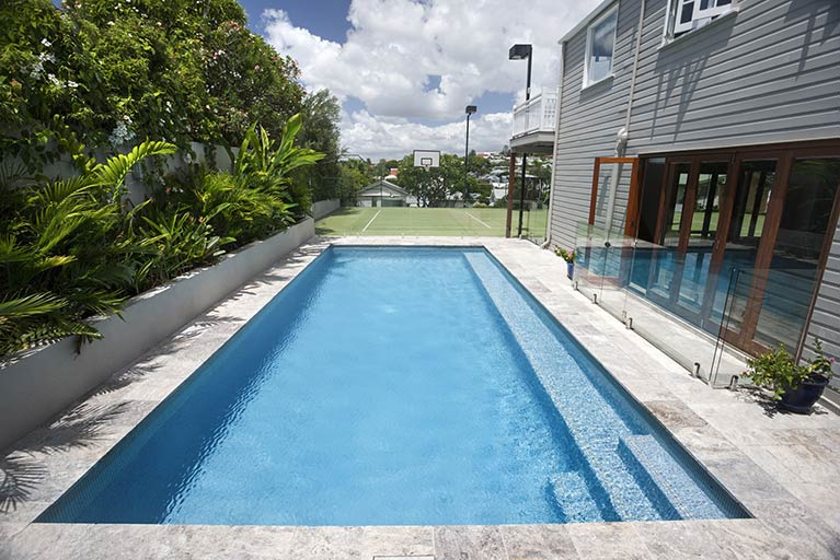 rectangle pool in backyard of queenslander clayfield
