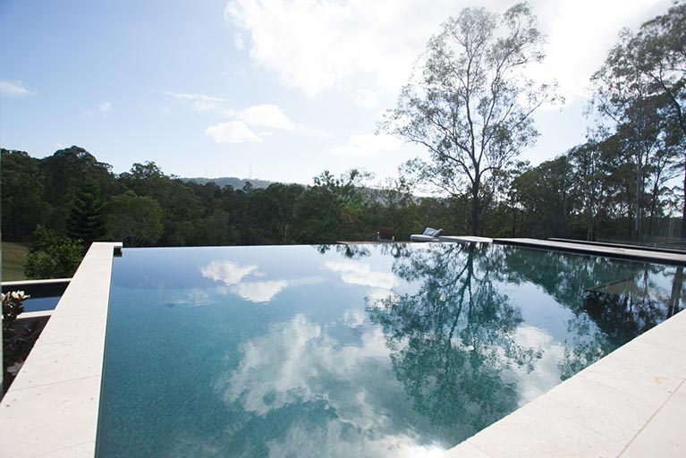 infinity pool overlooking bushland brookfield