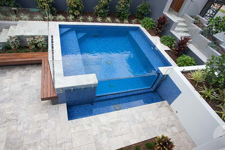 pool with wooden bench and glass balustrades carindale