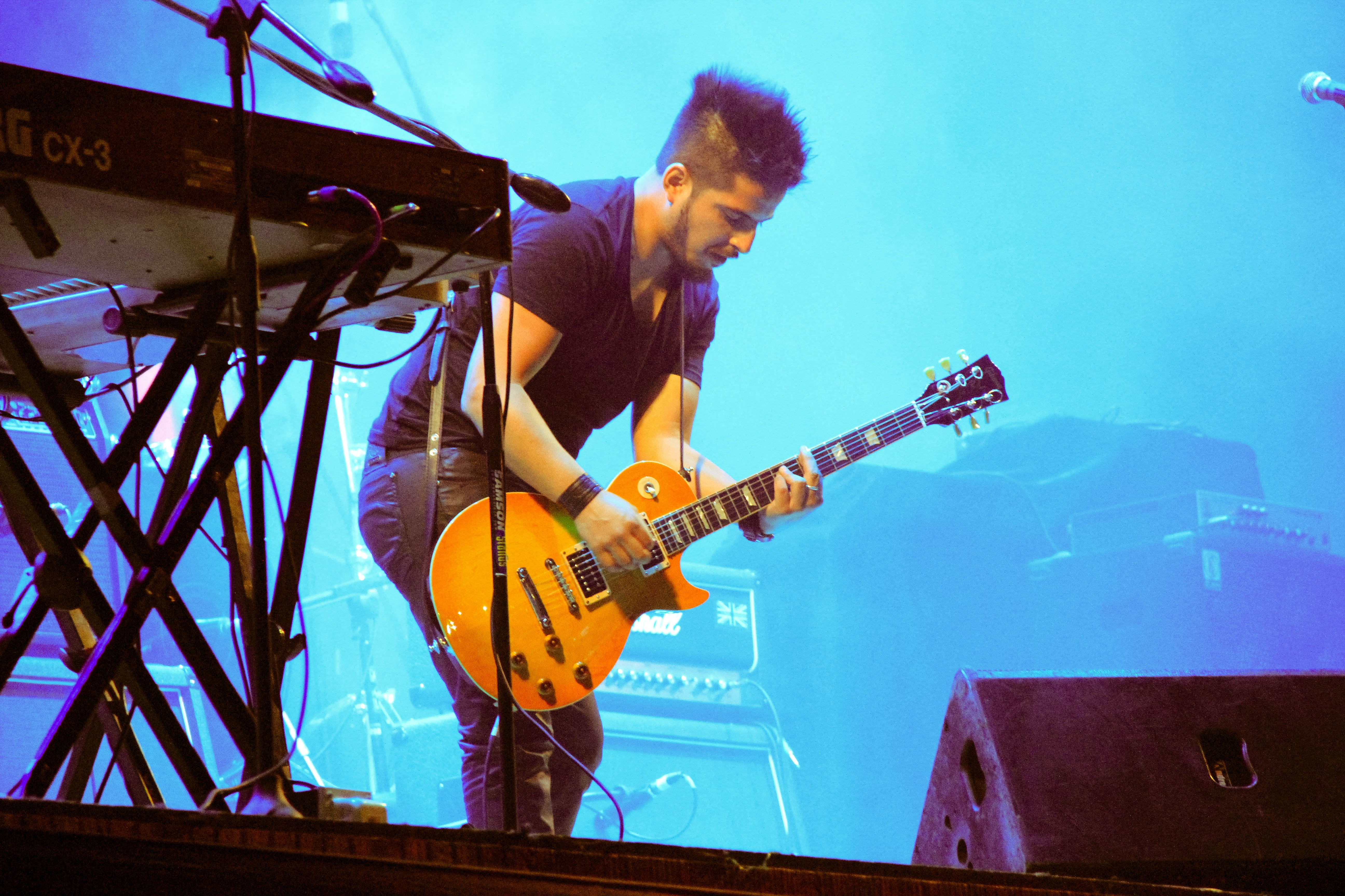 play guitar on stage