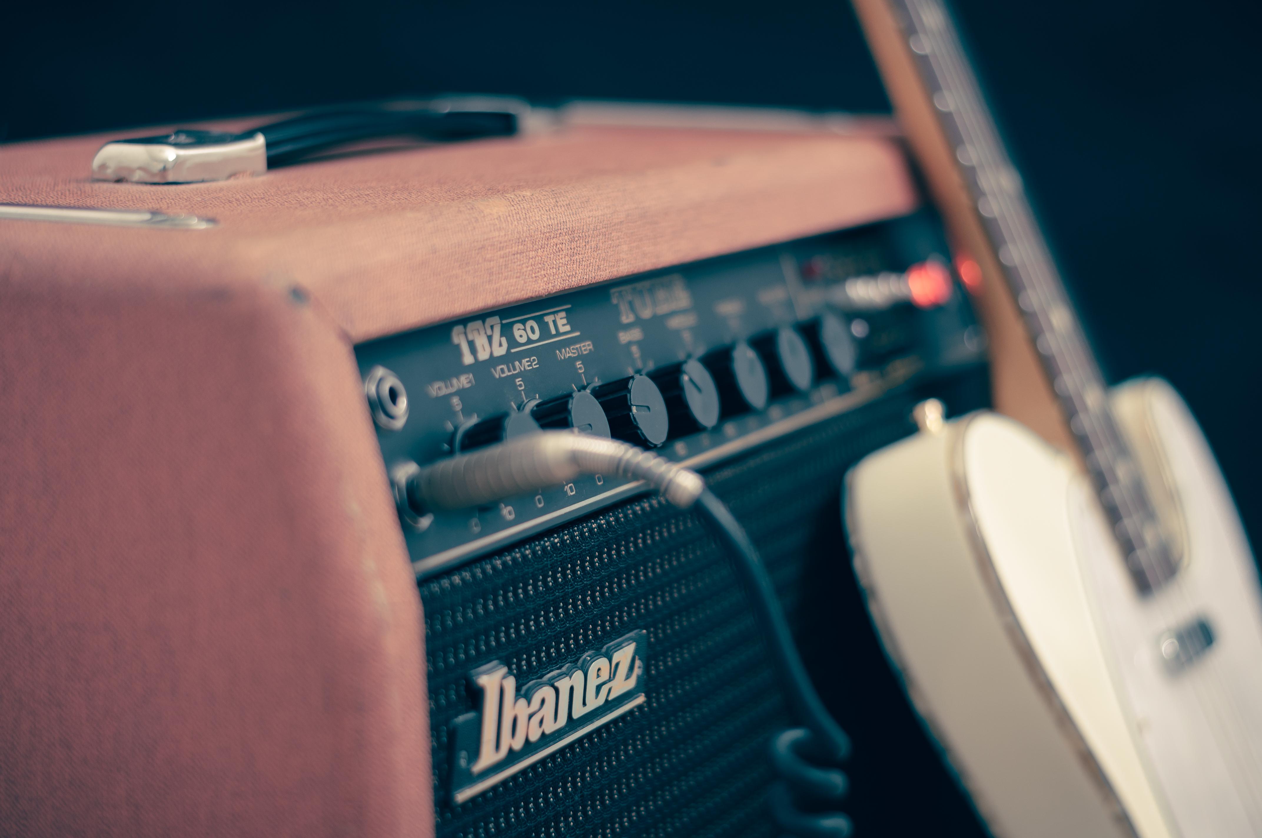 A guitar resting on an amplifier