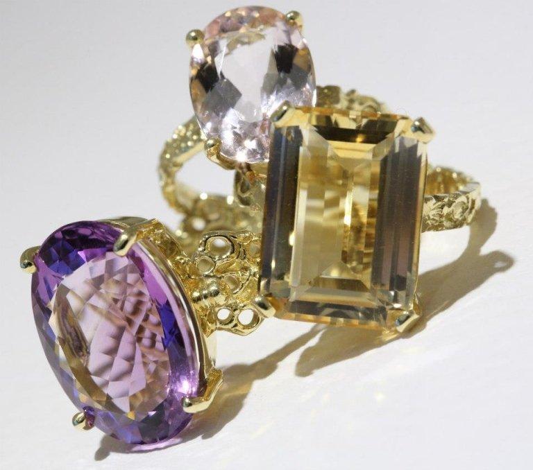 anelli in oro giallo con topazio e ametista