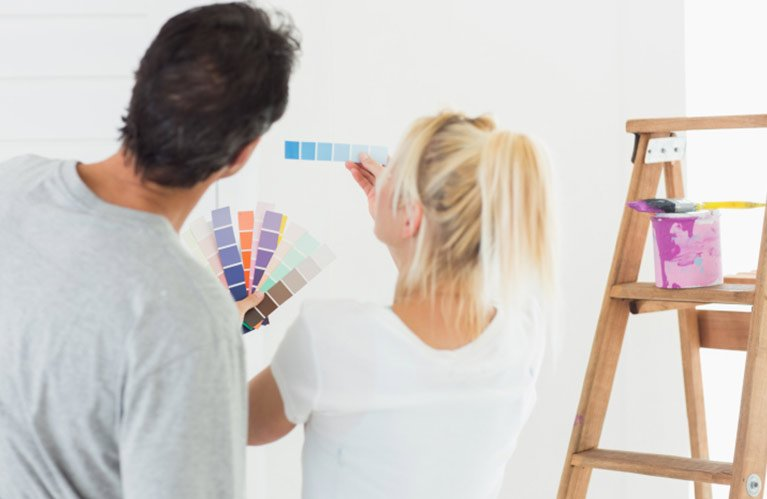 brilliance painting services couple looking at the colour palette