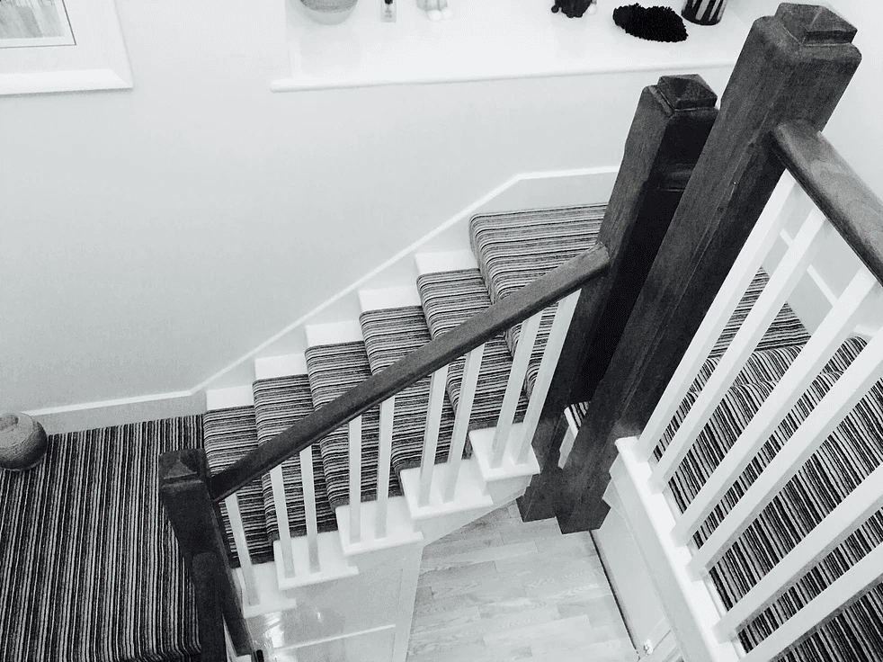 black and white image of carpeted stairs