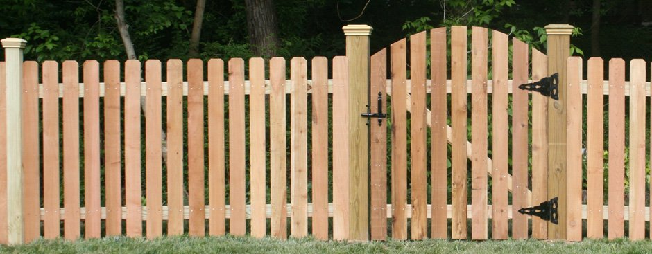 wood fence with an arched gate