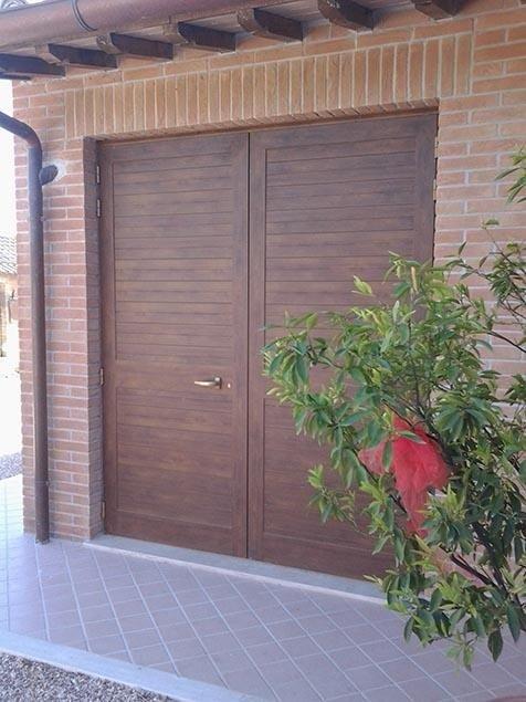 Porte garag in legno massello
