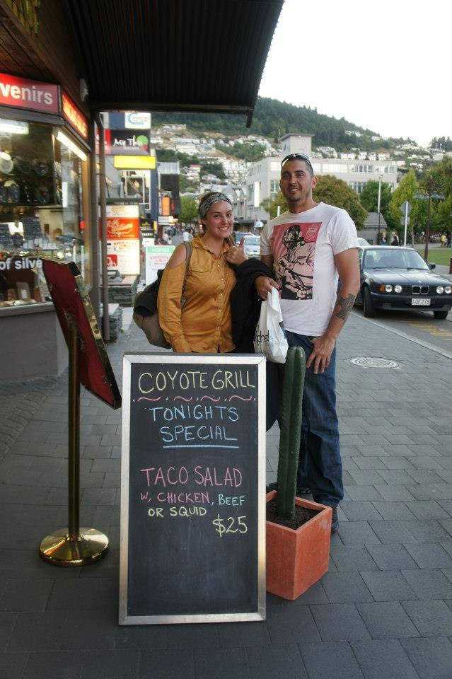 People standing in front of Coyote Grill