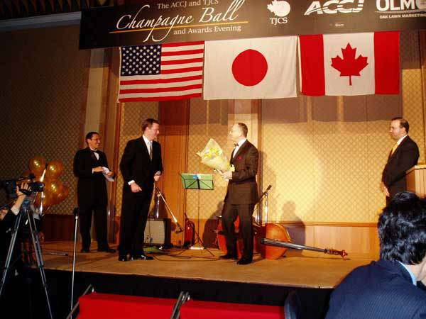 On stage at 2006 Champagne Ball
