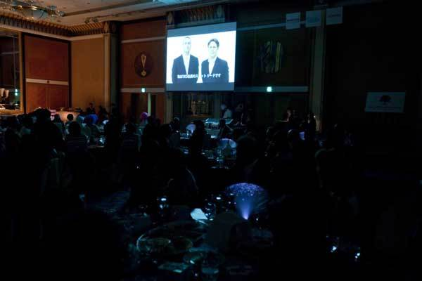 Watching a video at the 2011 Champagne Ball