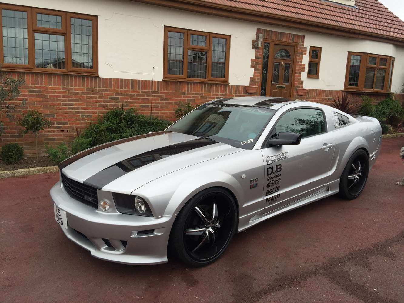 silver with black stripes ford mustang