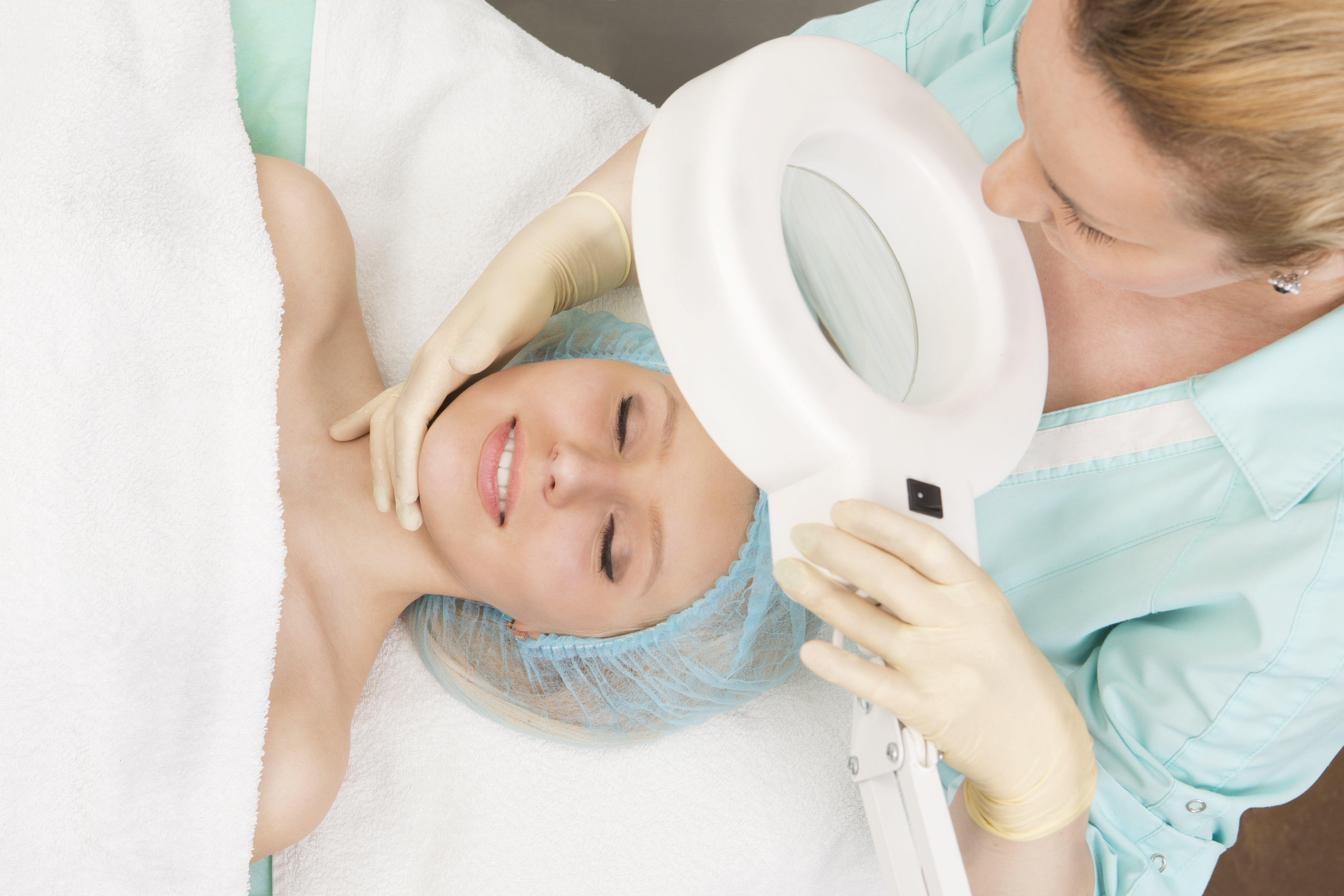 Woman gettingfacial hair removal treatment in Cincinnati, OH