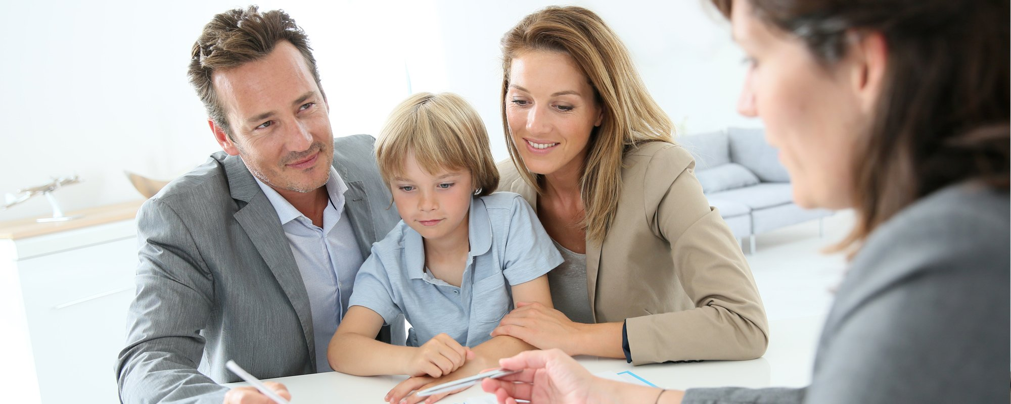 Young couple with their kid in a consultation session with the mortgage consultatnt