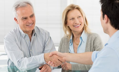 Old couple in a consultation session with the mortgage consultant