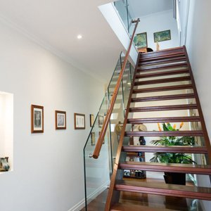 timber staircase with open treads and glass balustrading