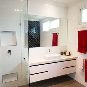 main bathroom with feature black tiled wall