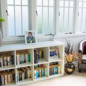 Parent's sitting room with original casement windows.