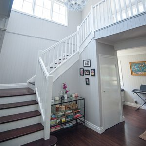 Staircase with timber treads and painted risers