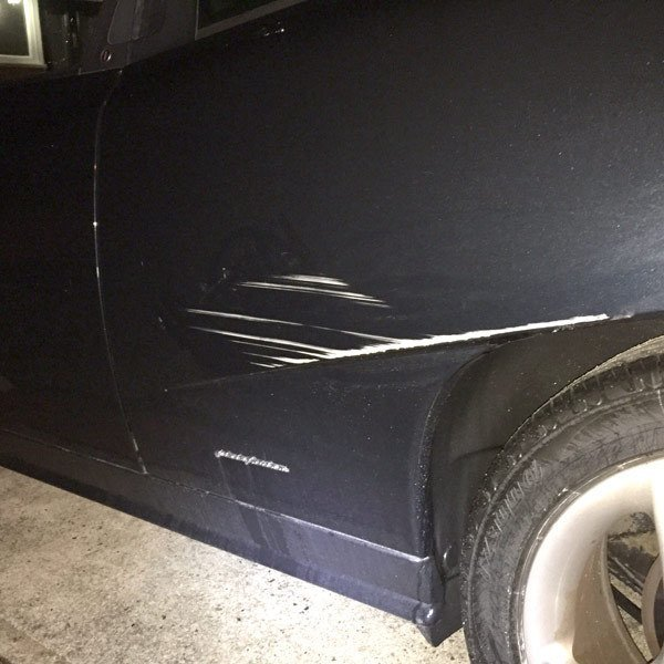 black car with scratches
