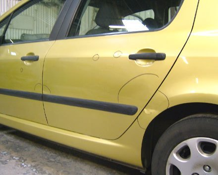 light yellow coloured car