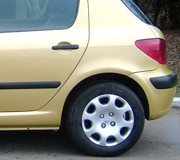 light yellow coloured car with black wheel