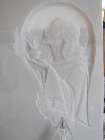 Rappresentazione religiosa in bassorilievo su marmo