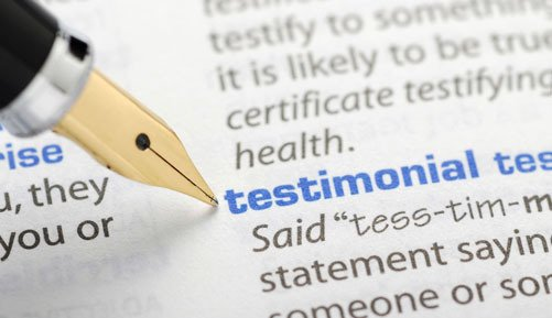 Definition of testimonial in dictionary with a pen nib
