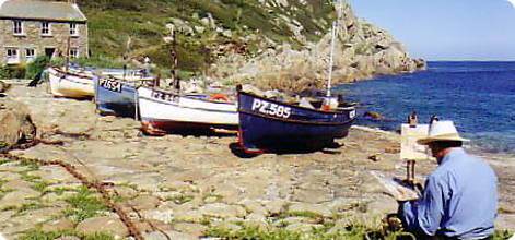 Artist painting Cornish coast and boats