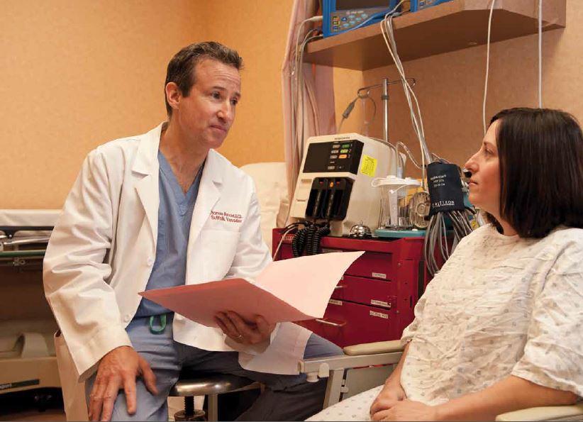 doctor seeing patient for vascular disease screening & treatment - Suffolk Vascular Center