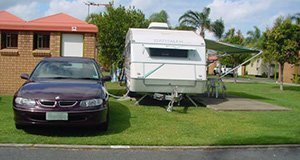 Exterior view of a house with a parked caravan