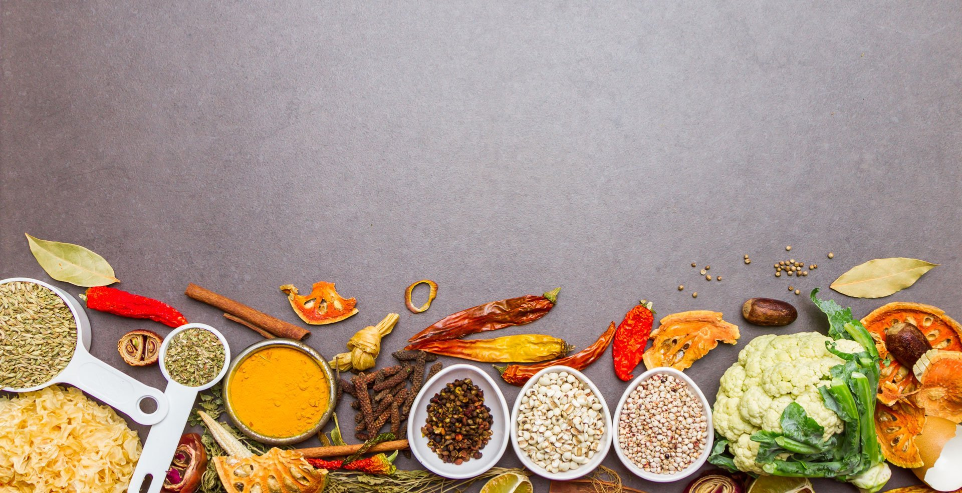 Spices and herbs on stone background, Top view indian mix spices and herbs difference ware on stone background with copy space for design spices, vegetables, herbs or foods content.