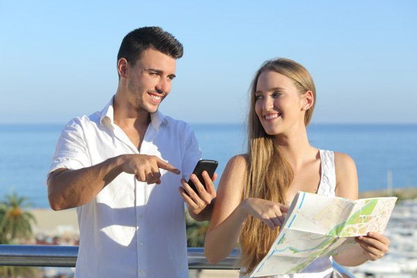 Couple looking for directions on maps