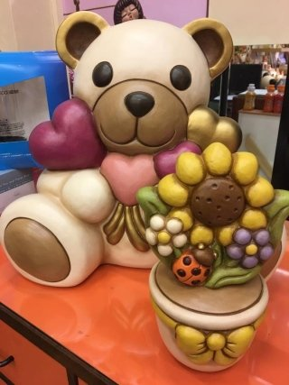 Teddy con mazzo di cuori