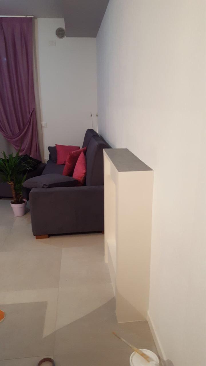 Stunning di un tubo della stufa in cartongesso e finitura con terre fiorentine with pareti - Parete in cartongesso costo ...