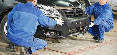 Auto technicians doing collision repair and auto body services in Groton, CT