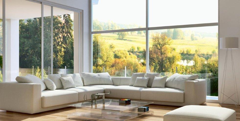 isolamento acustico sala con divani, cuscini, tavolo in vetro,infissi e pavimento in legno