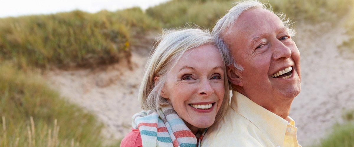 east st kilda eye clinic portrait of senior couple standing by sand dunes