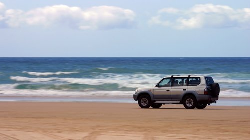 SUV moving on the beach