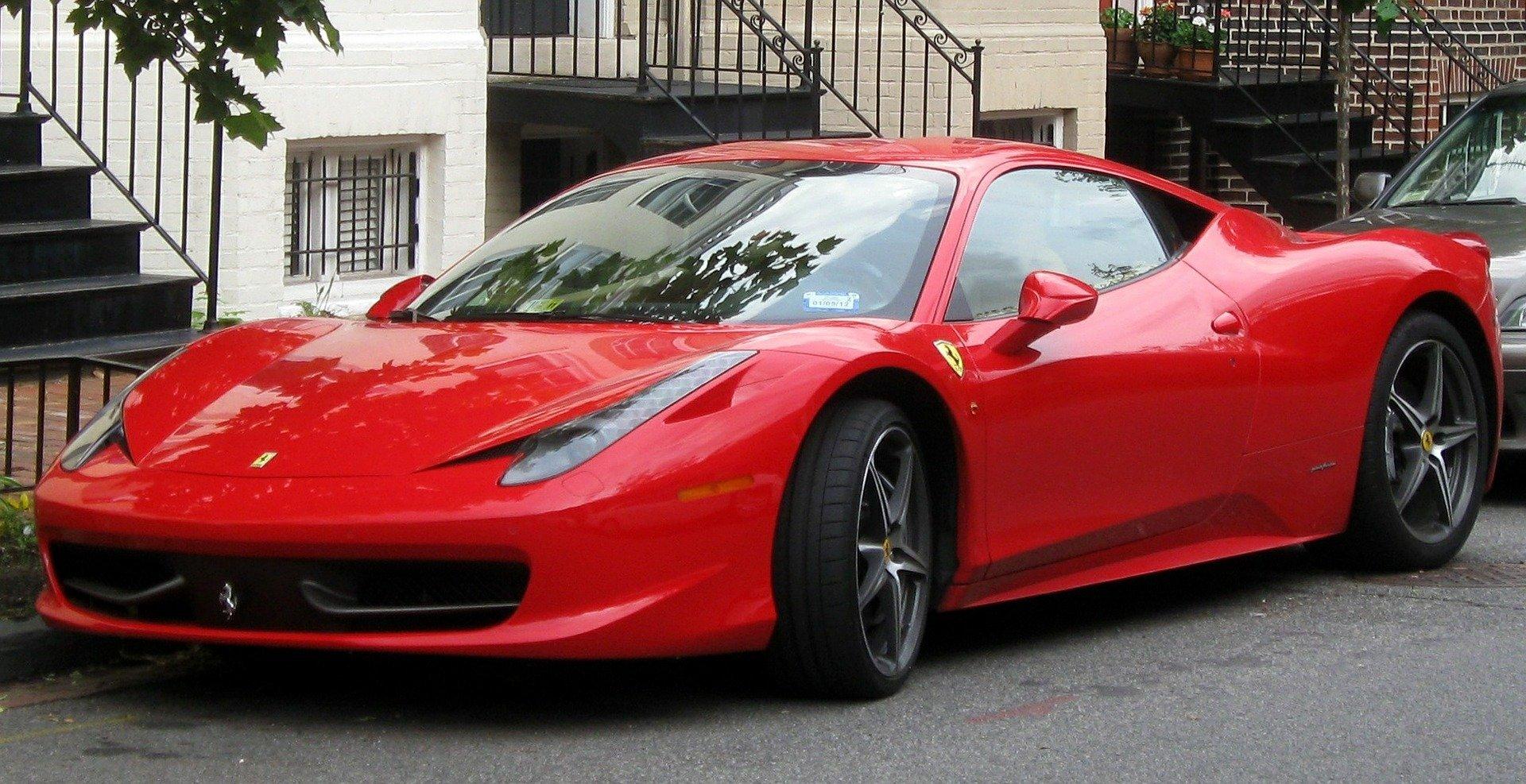 Famously dangerous red Ferrari 458 Italia parked on the street