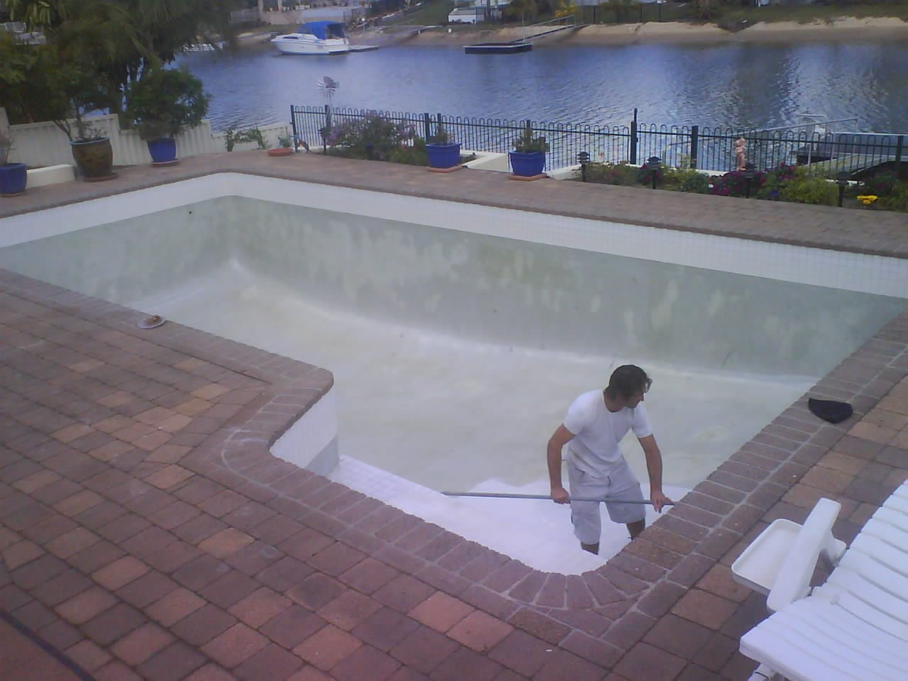 Specialist cleaning on the pool