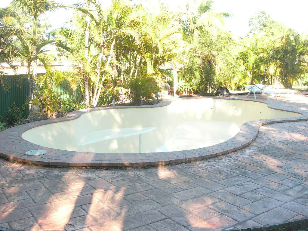View of the pool with sand colour resurfacing