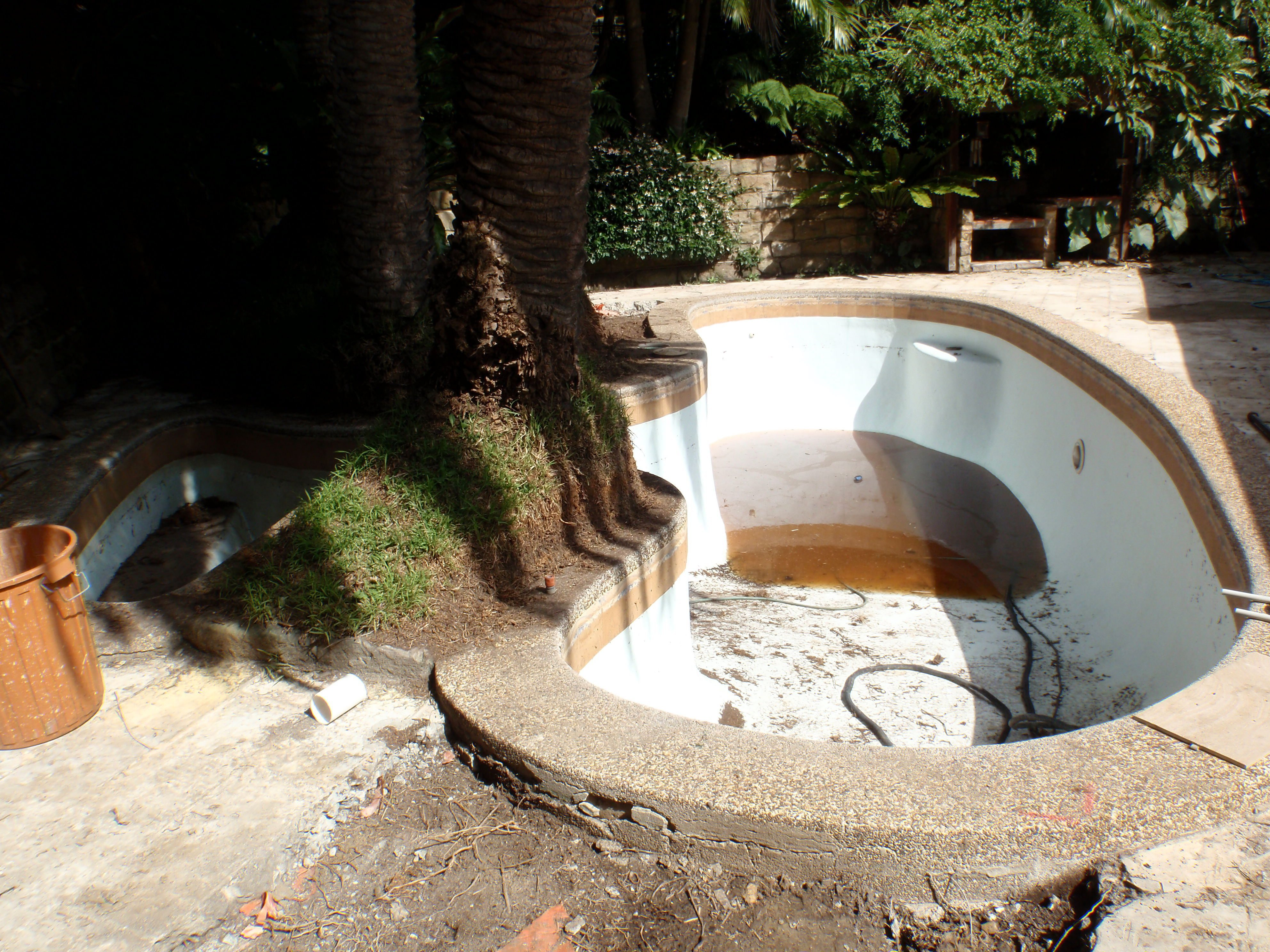 Pool being cleaned for restoration work