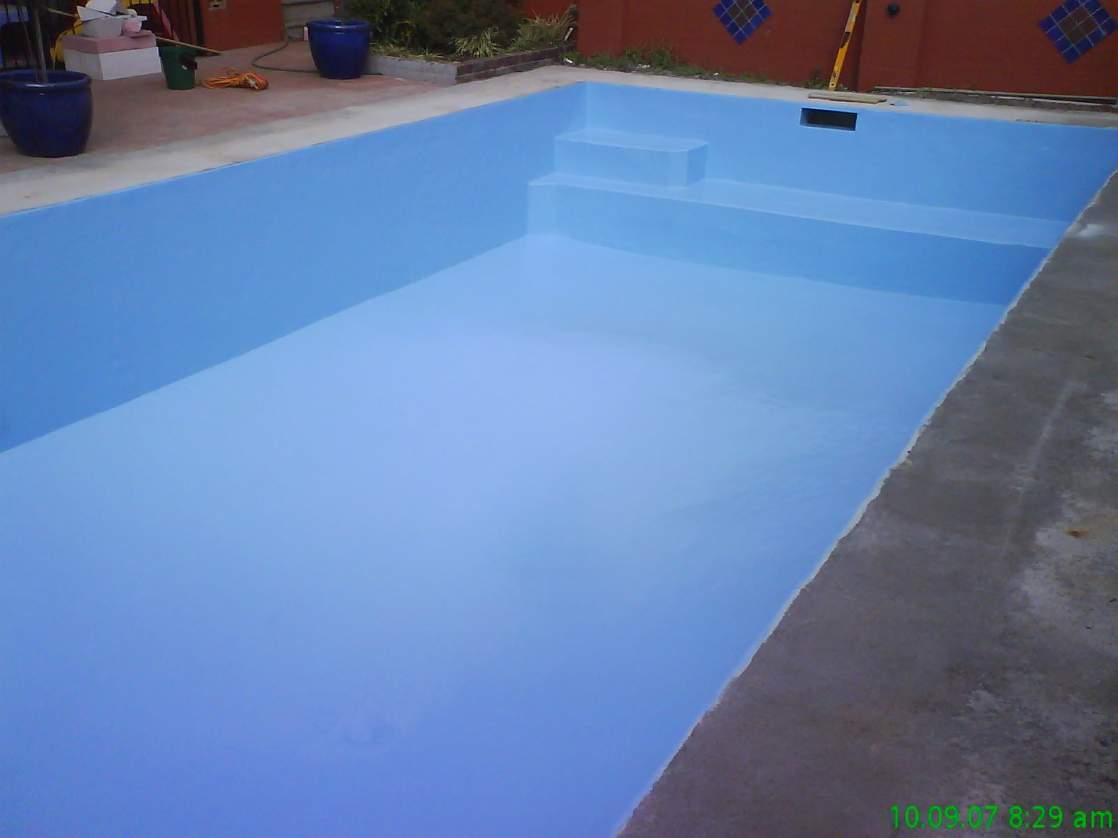 View of the pool with blue colour resurfacing