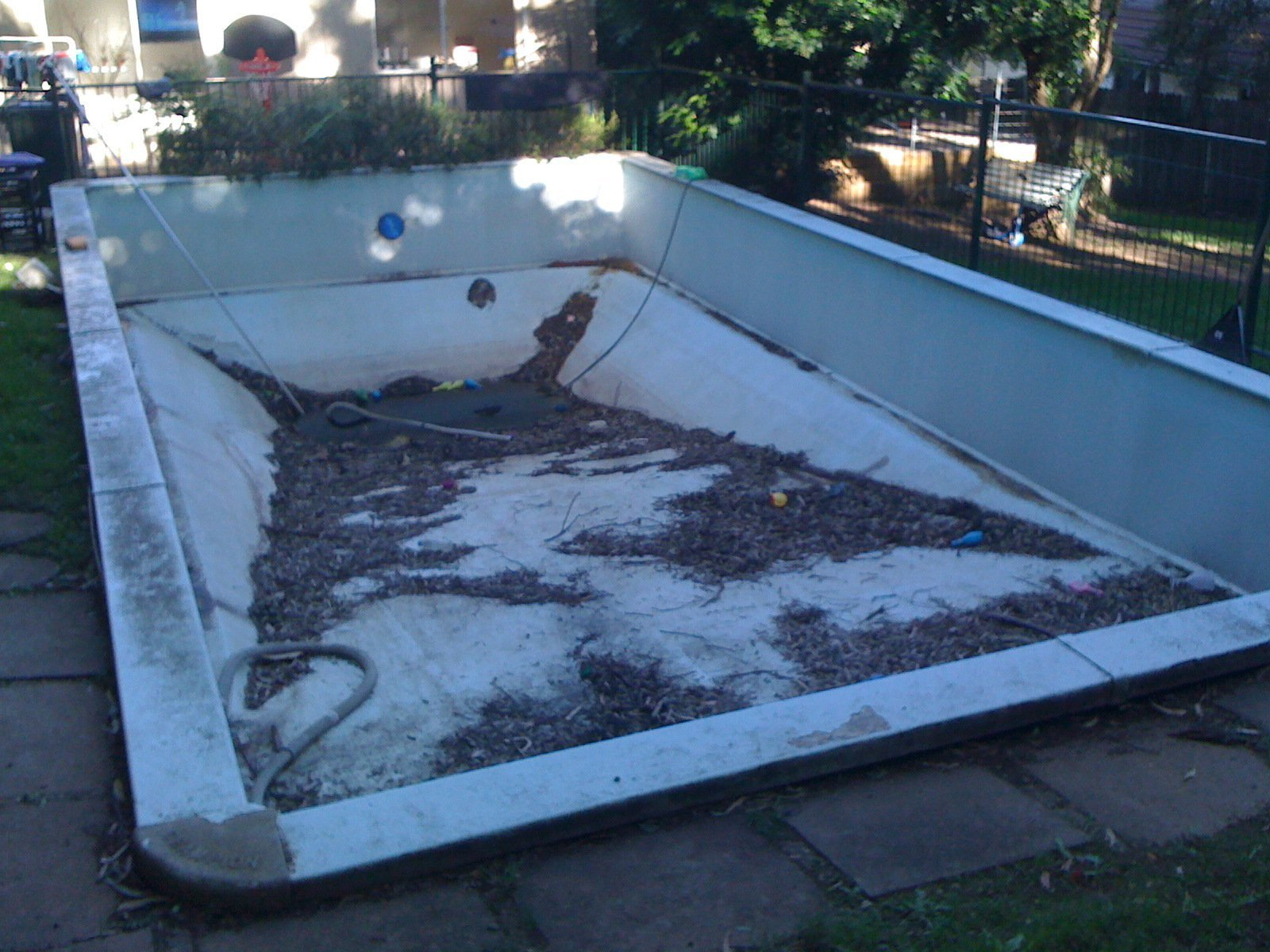 Old Vinyl Liner pool empty for pool resurfacing work
