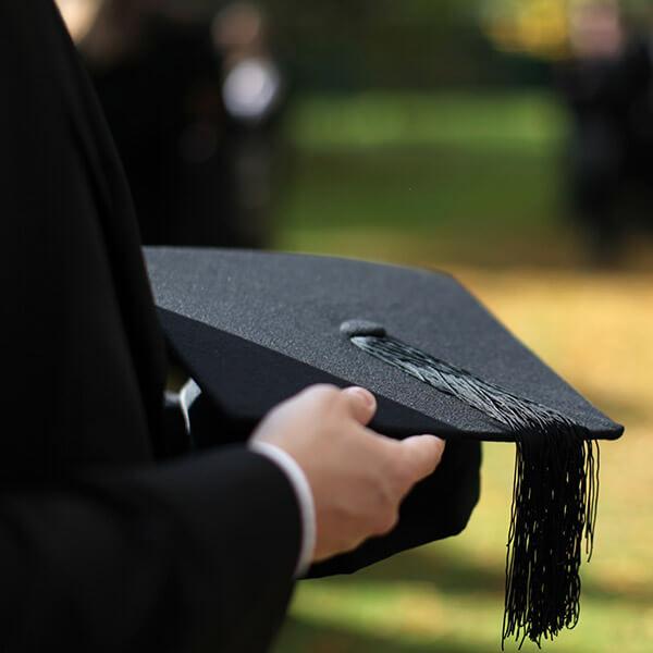 man holding graduation cap