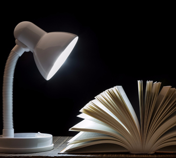 Reading lamp with an open book